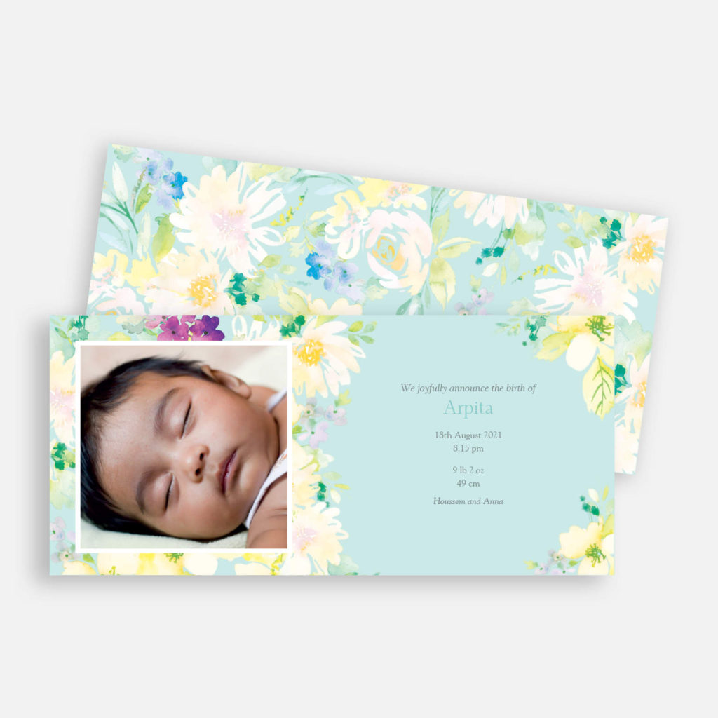 colourful birth announcement card with floral design and baby photo