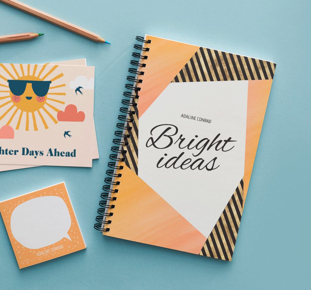 orange notebook with bright ideas written on the front