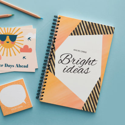 note book with bright ideas written on the front